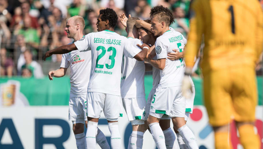 WORMS, GERMANY - AUGUST 18: Yuya Osako #8 of Werder Bremen celebrates with his tem-mates after scoring a goal to make it 1-0 during Wormatia Worms and Werder Bremen DFB Cup first round match on August 18, 2018 in Worms, Germany. (Photo by Maja Hitij/Bongarts/Getty Images)