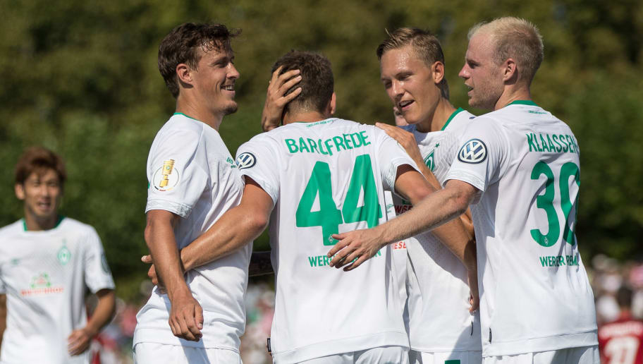 WORMS, GERMANY - AUGUST 18: Philipp Bargfrede #44 of Werder Bremen celebrates with his tem-mates after scoring a goal to make it 0-3 during Wormatia Worms and Werder Bremen DFB Cup first round match on August 18, 2018 in Worms, Germany. (Photo by Maja Hitij/Bongarts/Getty Images)