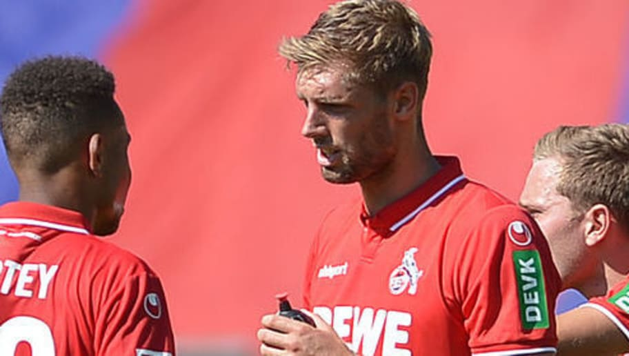 WUPPERTAL, GERMANY - JULY 08: Nikolas Nartey of Koeln speaks with Lasse Sobiech of Koeln after the friendly match between Wuppertaler SV and 1. FC Koeln on July 8, 2018 in Wuppertal, Germany. (Photo by TF-Images/Getty Images)
