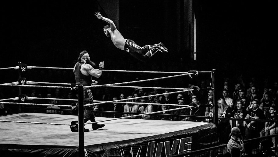 DUESSELDORF, GERMANY - FEBRUARY 22: (EDITORS NOTE: Image has been converted to black and white.) Braun Strowman (L) is attacked by Sami Zayn (R) during to the WWE Live Duesseldorf event at ISS Dome on February 22, 2017 in Duesseldorf, Germany. (Photo by Lukas Schulze/Bongarts/Getty Images)