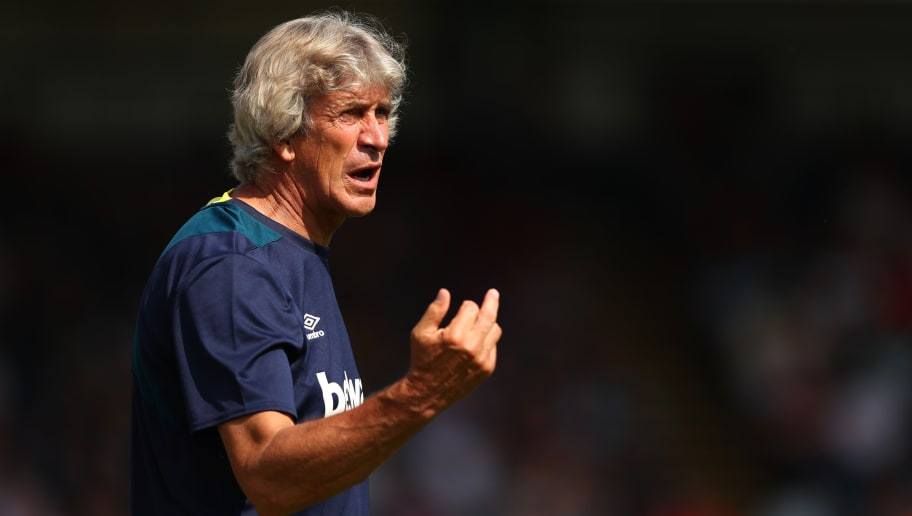 HIGH WYCOMBE, ENGLAND - JULY 14:  West Ham manager Manuel Pellegrini issues instructions to his players during the pre-season friendly match between Wycombe Wanderers and West Ham United at Adams Park on July 14, 2018 in High Wycombe, England.  (Photo by Dan Istitene/Getty Images)