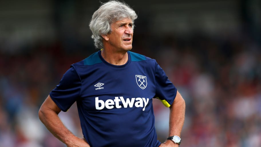 HIGH WYCOMBE, ENGLAND - JULY 14:  West Ham manager Manuel Pellegrini looks on during the pre-season friendly match between Wycombe Wanderers and West Ham United at Adams Park on July 14, 2018 in High Wycombe, England.  (Photo by Dan Istitene/Getty Images)