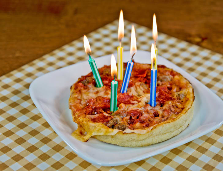 Deep fish pizza with candles in it