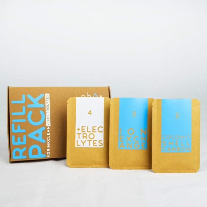 A cardboard box and three Phox refill packs