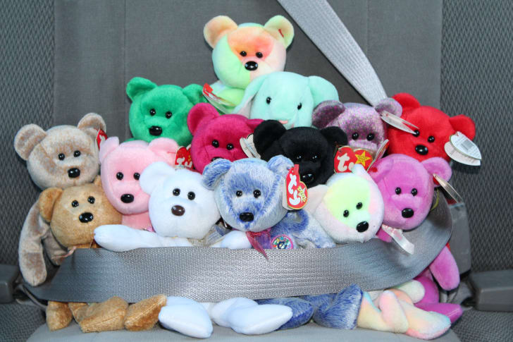 Beanie Babies strapped into seatbelt in a car