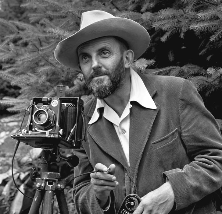 A photo of Ansel Adams with his camera