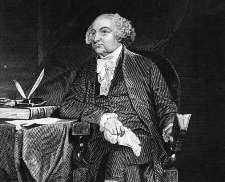 An illustration of John Adams at a writing desk