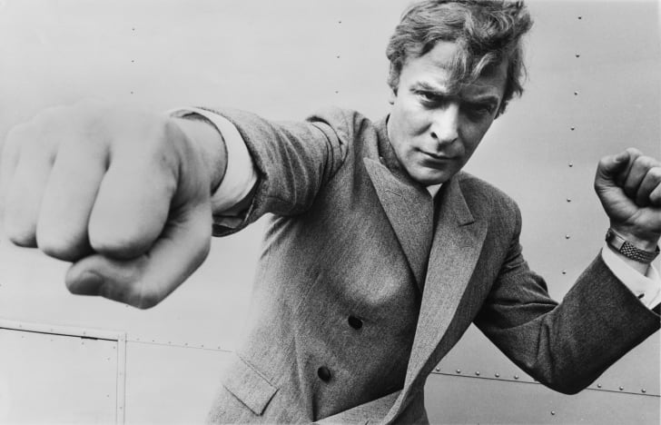 English actor Michael Caine, throwing a punch, August 1965