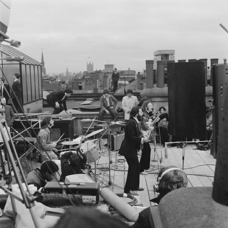 British rock group the Beatles performing their last live public concert on the rooftop of the Apple Organization building for director Michael Lindsey-Hogg's film documentary, 'Let It Be,' on Savile Row, London, UK, 30th January 1969