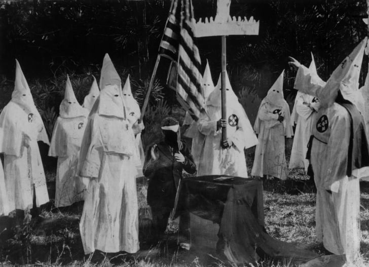 Members of the Ku Klux Klan gather for a ceremony in the 1920s