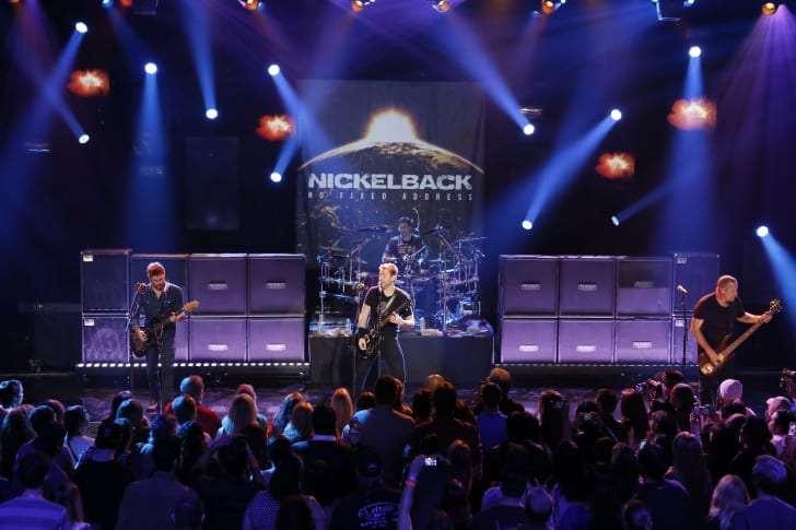 (L-R) Ryan Peak, Chad Kroeger, Daniel Adair (back) and Mike Kroeger from the band Nickelback performs at iHeartRadio Theater on November 18, 2014 in Burbank, California