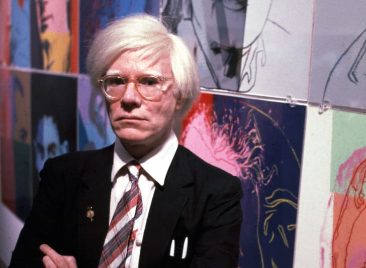 The American artist and filmmaker Andy Warhol with his paintings(1928 - 1987), December 15, 1980