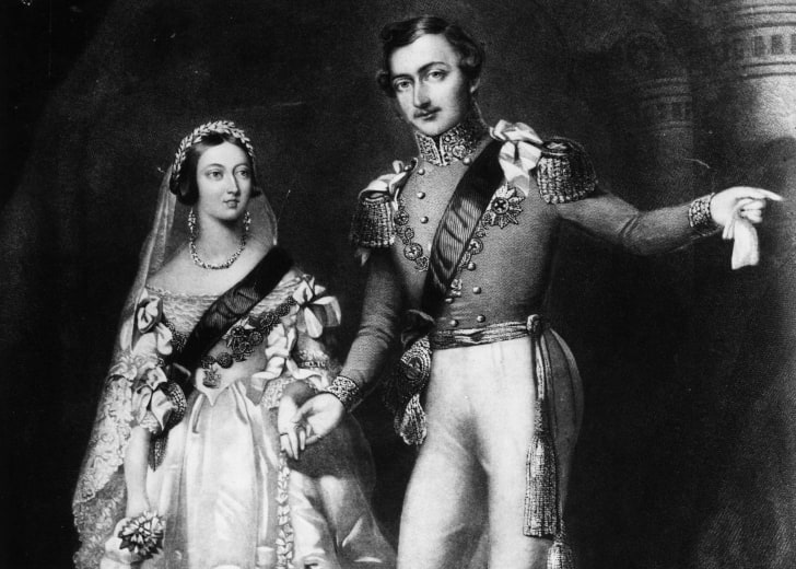 An engraving of Albert and Victoria in wedding clothes