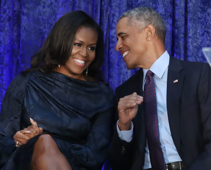 Former U.S. President Barack Obama and first lady Michelle Obama participate in the unveiling of their official portraits during a ceremony at the Smithsonian's National Portrait Gallery, on February 12, 2018 in Washington, DC