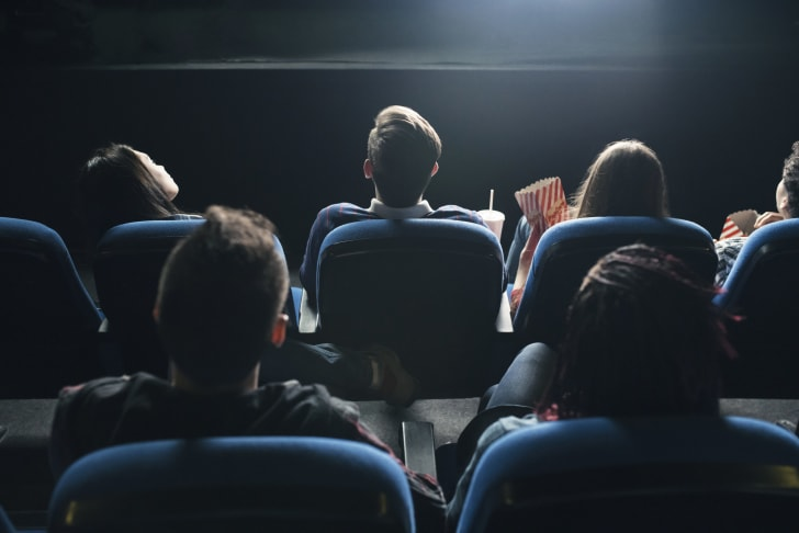 An audience watches a movie in a cinema