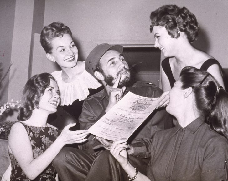 Fidel Castro surrounded by four women