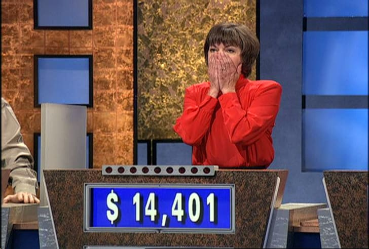 Jeopardy contestant Nancy Zerg puts her hands to her mouth in shock after beating champion Ken Jennings in 2004.