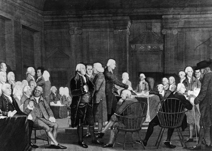 Members of the Second Continental Congress prepare documentation for the Declaration of Independence