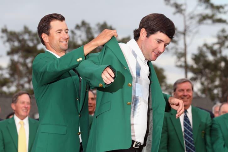 Adam Scott giving  Bubba Watson the green jacket