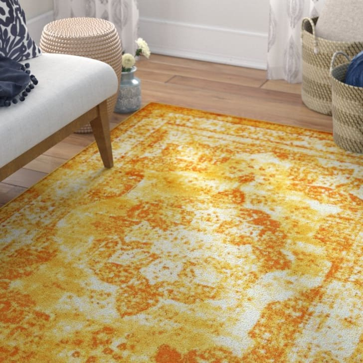 A yellow and orange area rug
