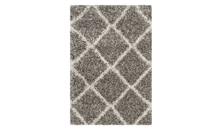 A gray rug with a crosshatch pattern