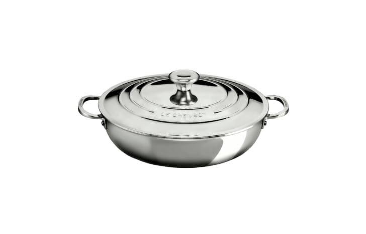 A stainless steel Le Creuset braiser with the lid on