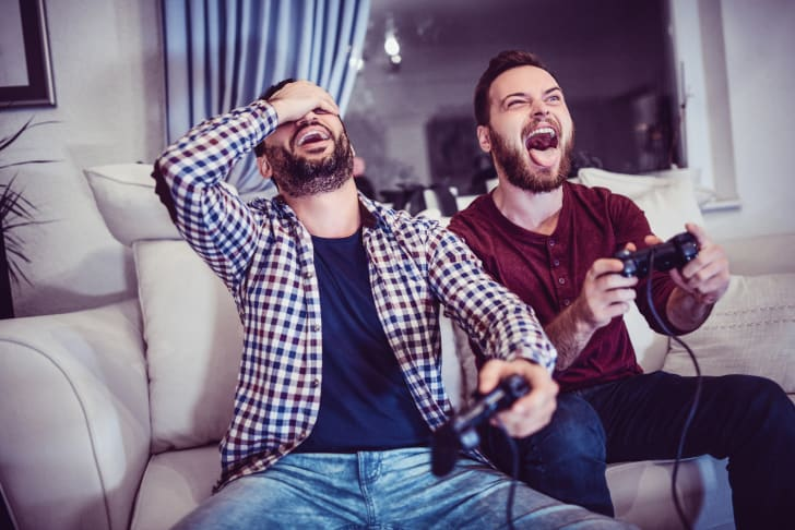 man defeating other man at video games