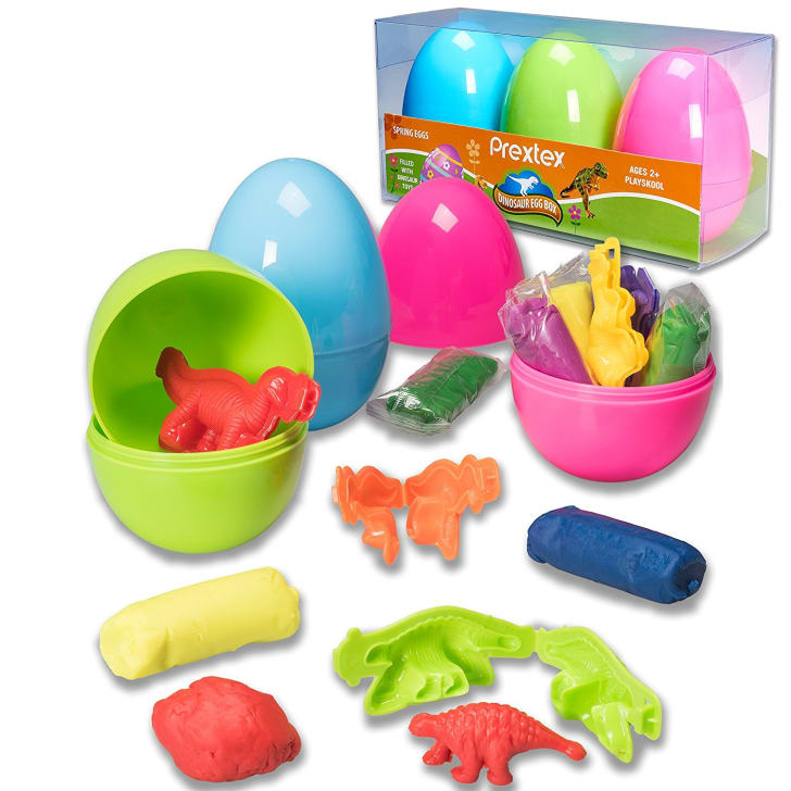 Easter eggs stuffed with modeling clay in the shape of dinosaurs