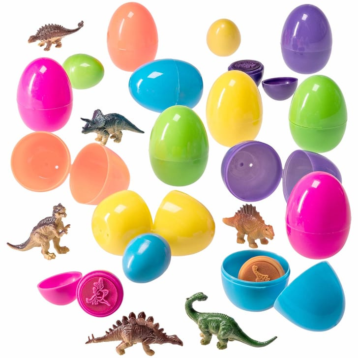 Dinosaur toys and stamps with plastic Easter eggs