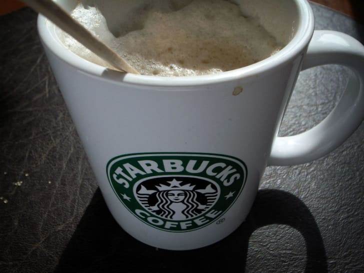 A Starbucks coffee cup is seen in close-up