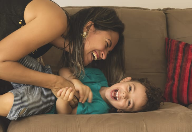 Mom and boy laughing on couch