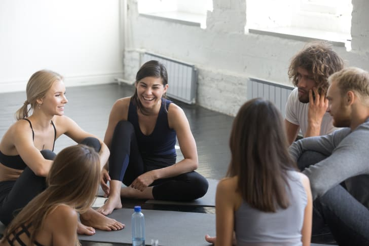 group laughing in a workout class