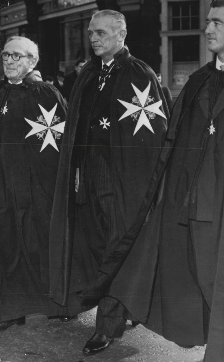 Actor Douglas Fairbanks Jr. in 1958 wearing the mantle and insignia of a Knight of Justice of the Order of St. John.