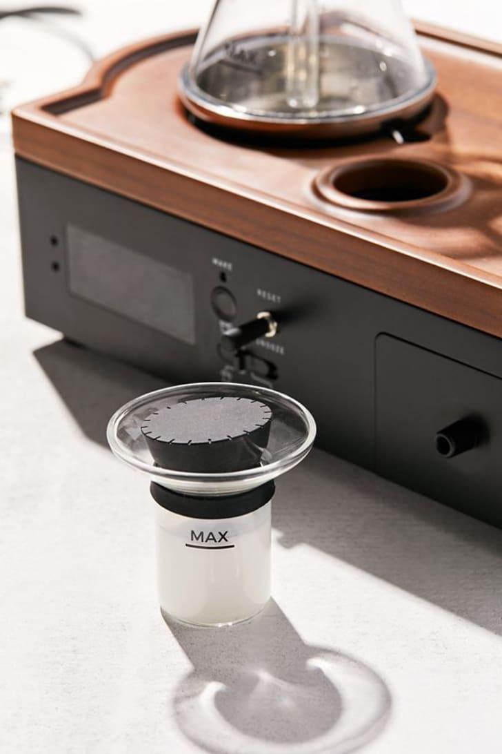 The milk vessel of the coffee alarm clock