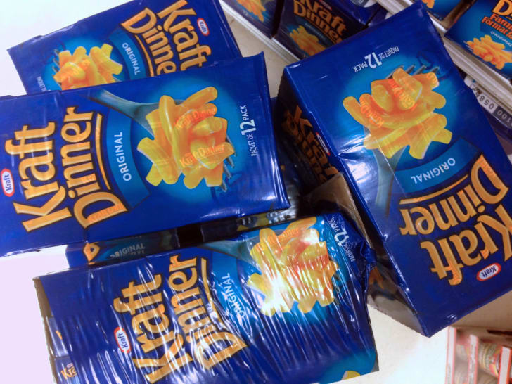 Boxes of Kraft Dinner wrapped in plastic