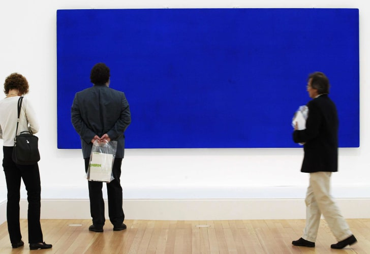 Visitors look at 'Monochrome Blue, without title' (1960) by French artist Yves Klein