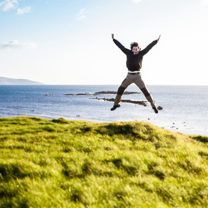Man jumps in the air for joy