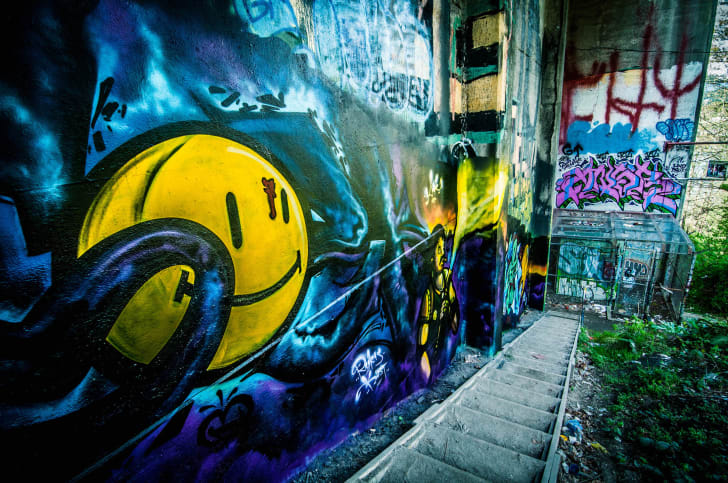 Watchmen smiley face graffiti