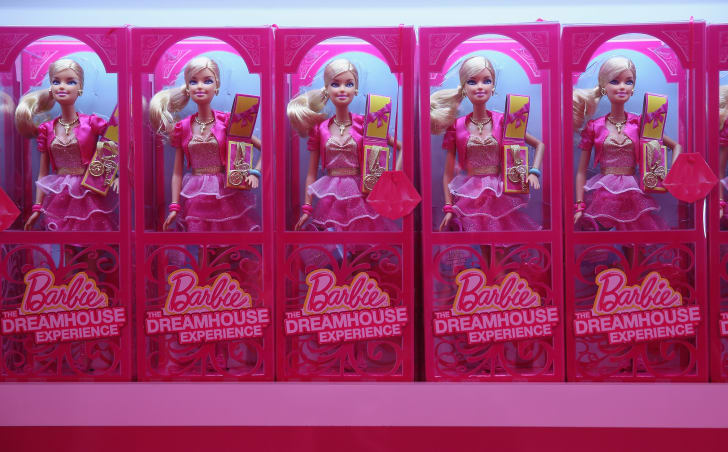 Row of Barbies in pink boxes