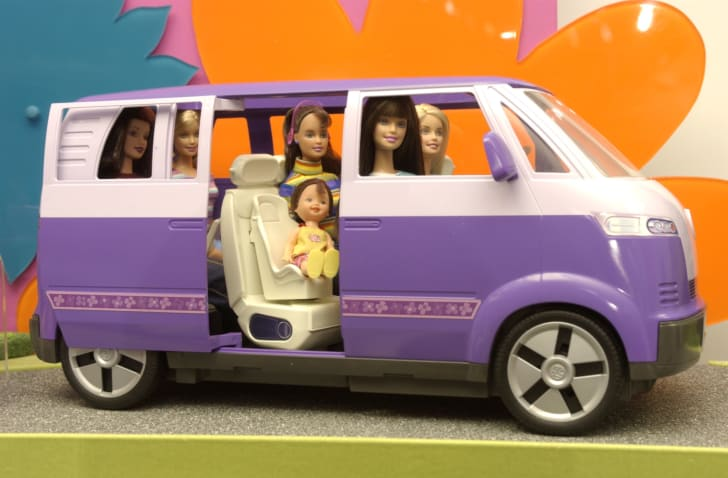 A Barbie van filled with dolls