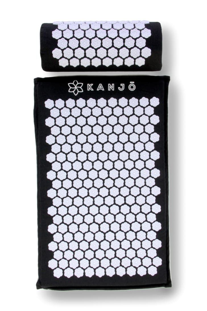 A black and white acupressure mat