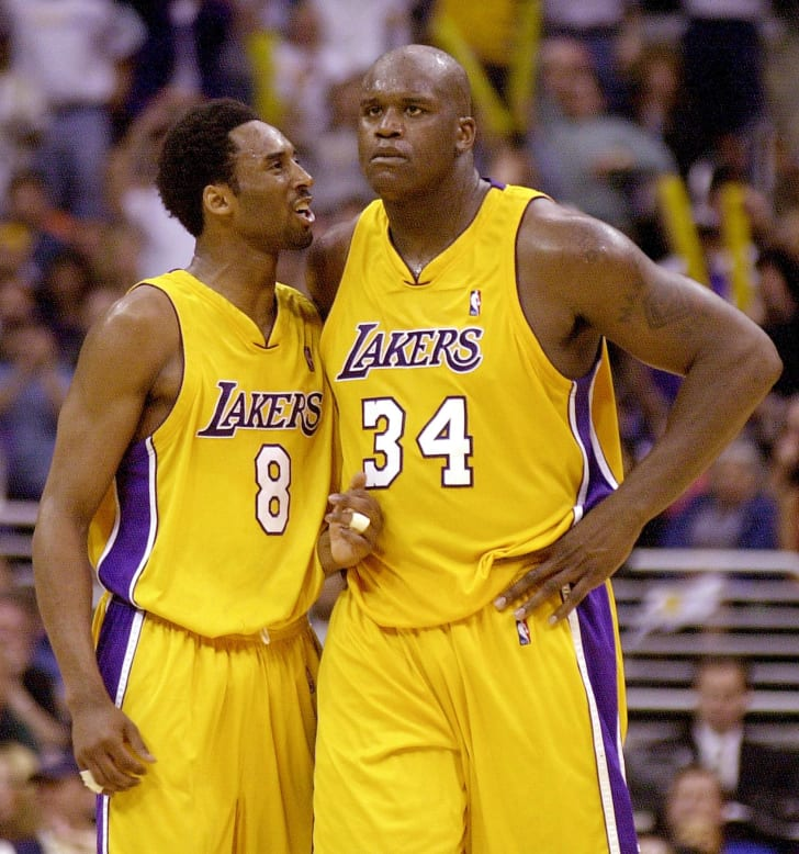 Los Angeles Lakers Kobe Bryant and Shaquille O'Neal during a game in 2001.