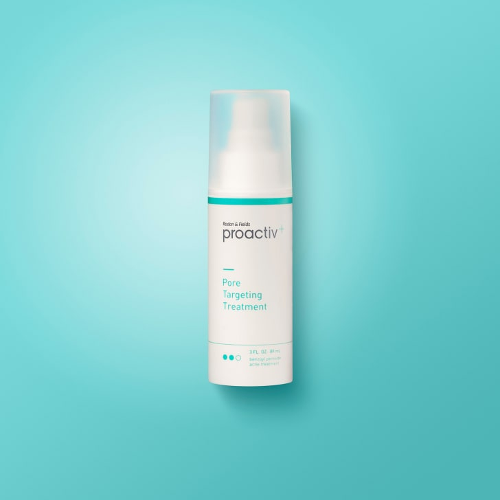 A bottle of Proactiv solution on a blue background