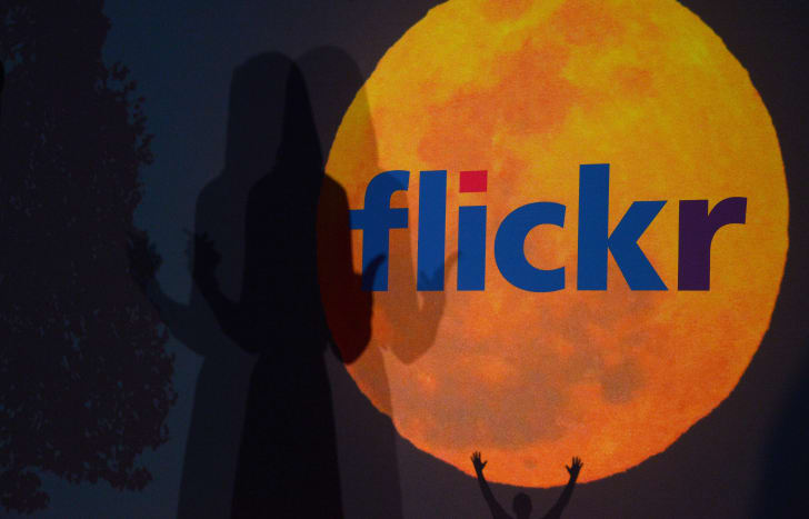 A logo for the Flickr website is displayed during an announcement in 2013