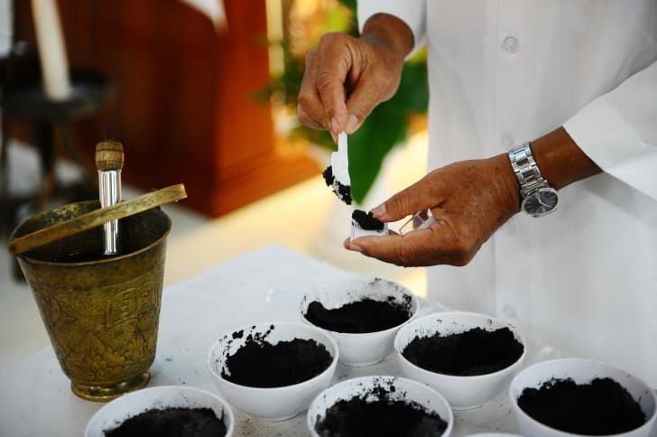 A priest prepares black ashes for the Ash Wednesday ceremony in Surabaya, Indonesia in 2014.