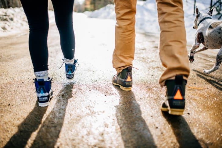 People wearing boots walking outside.