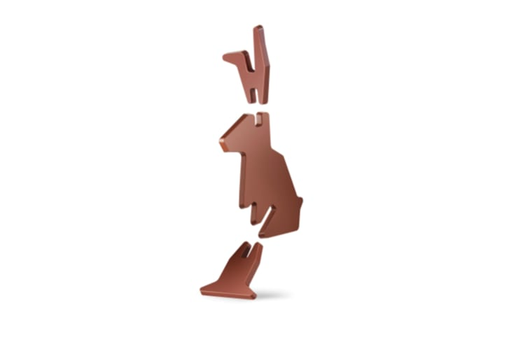 Chocolate bunny being assembled.