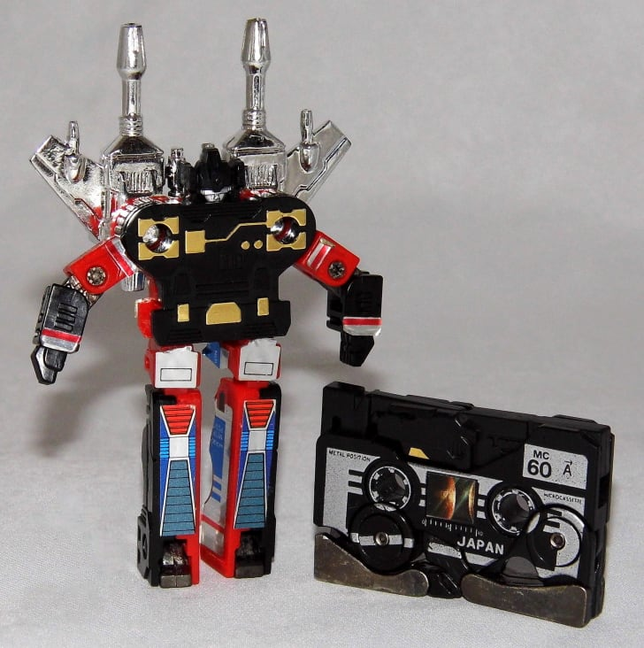 A Transformers action figure and cassette