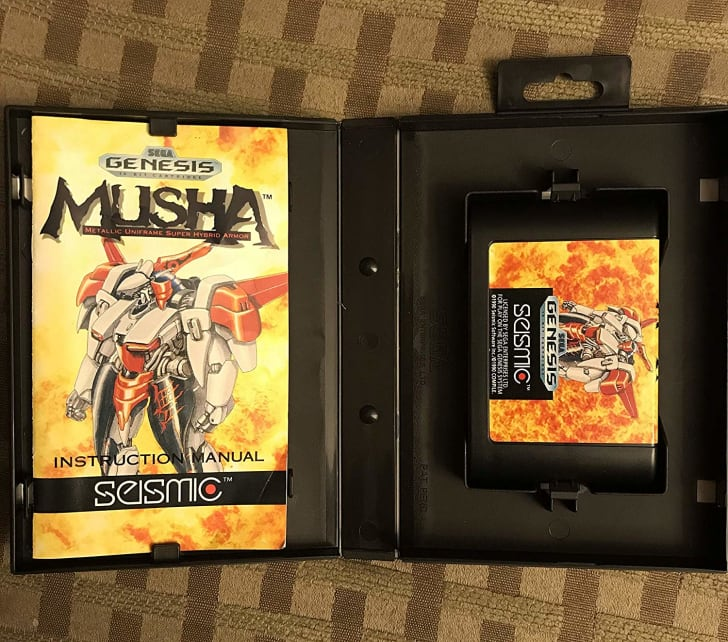 A copy of M.U.S.H.A. for Sega Genesis in its box