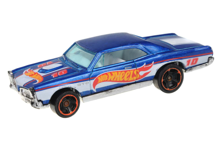 A Hot Wheels 67 Pontiac GTO toy car